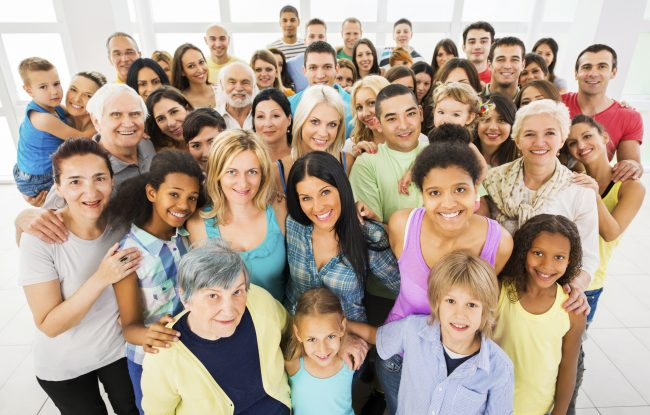 Large group of happy people standing embraced and looking at the camera. [url=http://www.istockphoto.com/search/lightbox/9786738][img]http://dl.dropbox.com/u/40117171/group.jpg[/img][/url]